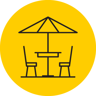 Illustration of a table and chairs under an umbrella