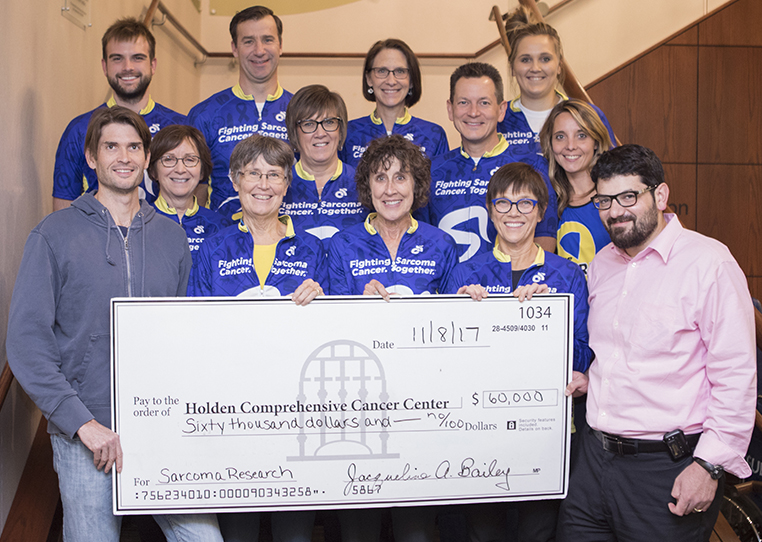 Courage Ride committee presents check to Ben Miller, MD, orthopedic surgeon, and Munir Tanas, MD, pathologist, co-leaders of the Holden Comprehensive Cancer Center Sarcoma Multidisciplinary Oncology Group