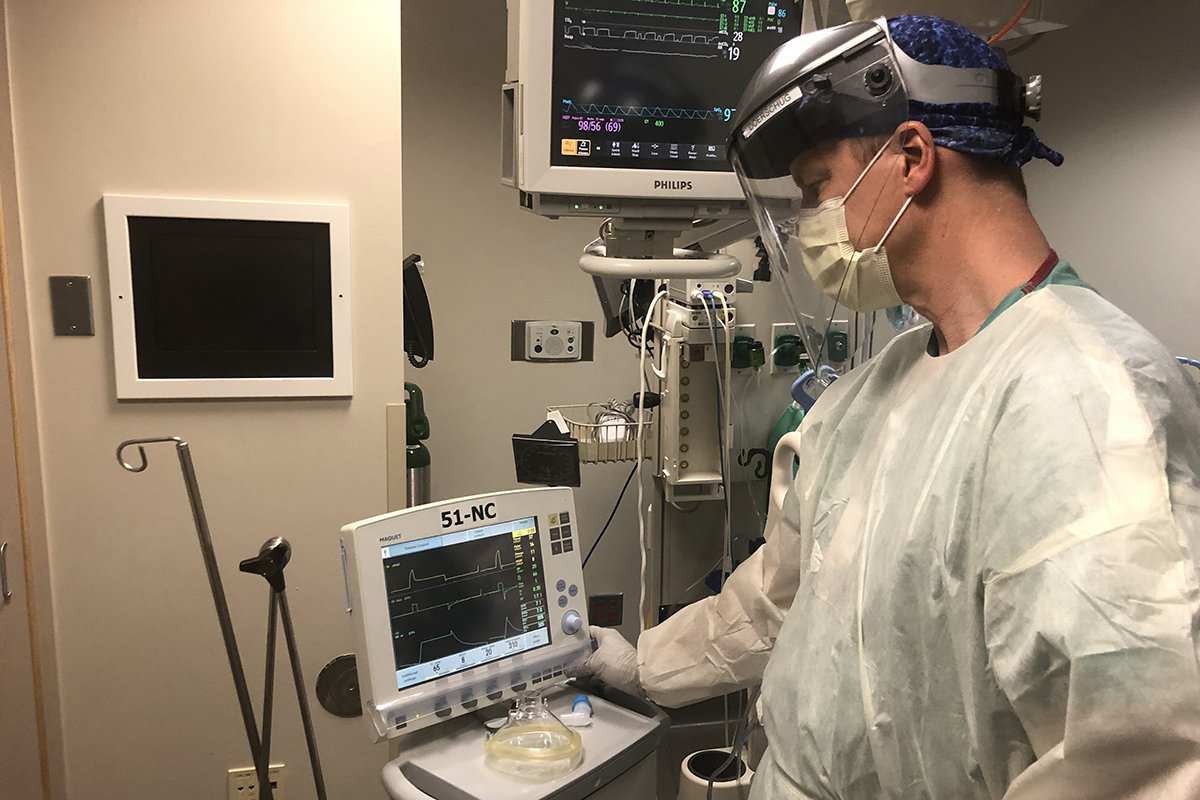 Kevin Doerschug, medical director of the Medical Intensive Care Unit, views monitoring equipment used outside a patient's room to monitor intubations.