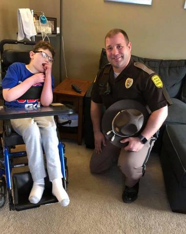 Caleb Helland and the Iowa State Patrol trooper who delivered his medication