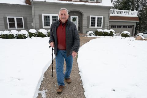 Alan Leff in front of his University Heights home
