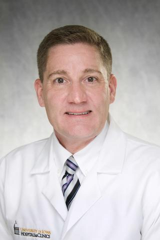 Daniel Fick, MD in white coat