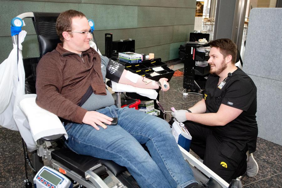 Man gives blood at a Degowin Blood Center blood drive