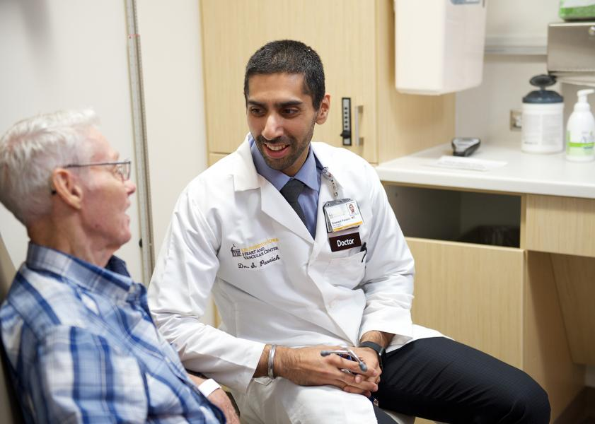 Sidakpal Panaich, MBBS, speaks with a patient