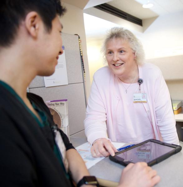 Staff member greeting a patient.