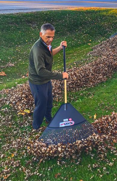 Howard Dittrich raking leaves