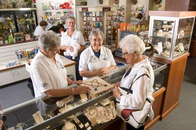 Four Hospital Volunteers in Gift Shop