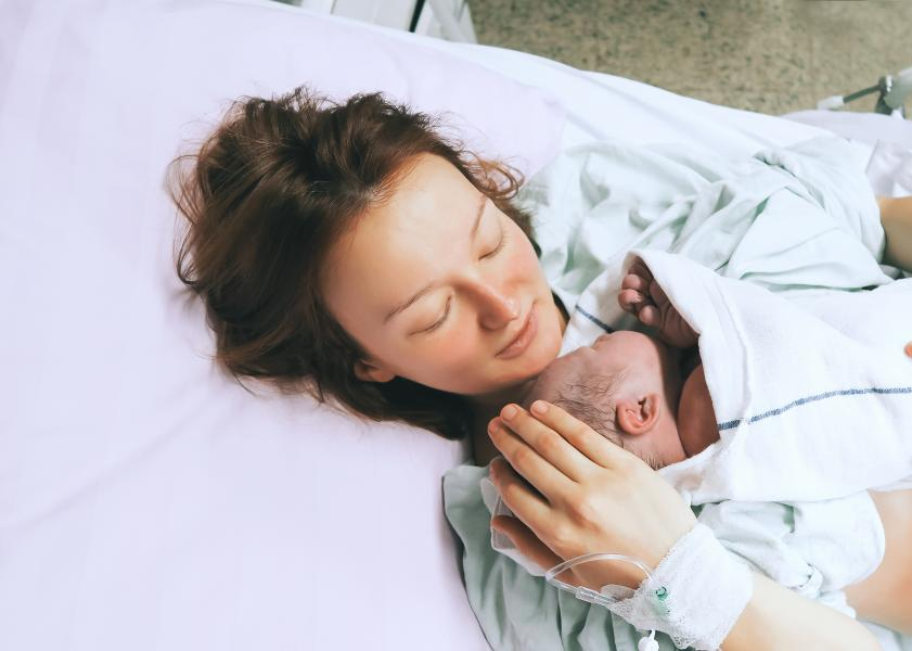 Mother and newborn rest together after labor