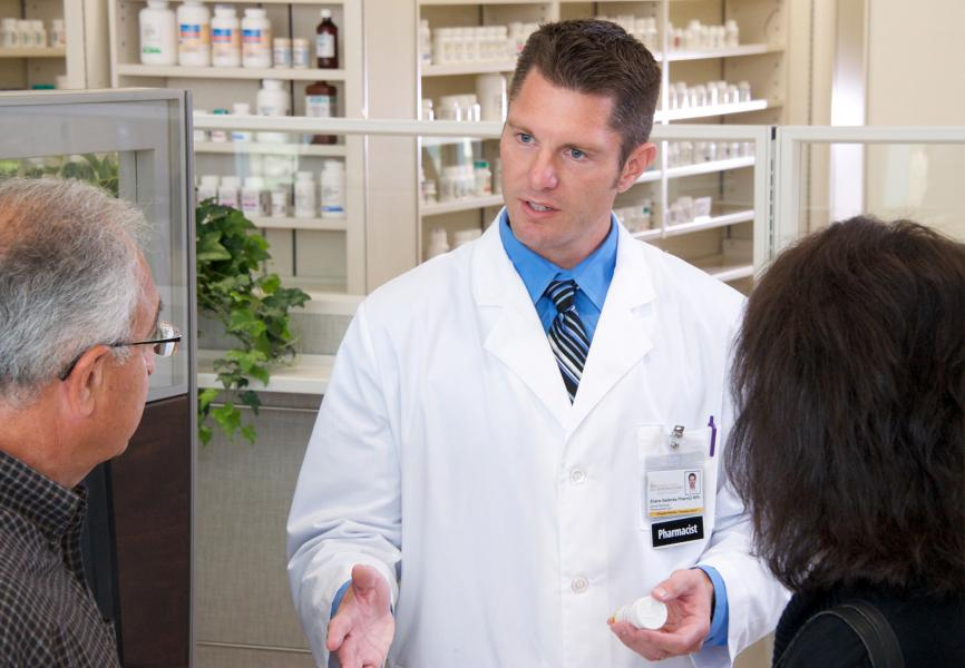 Pharmacist meeting with patients