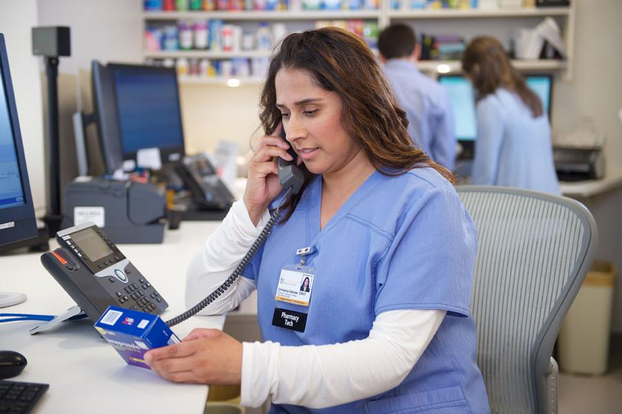 Pharmacy specialist on the telephone