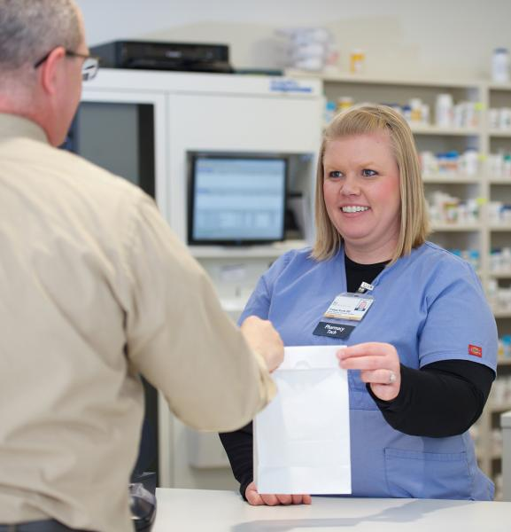 Pharmacy Tech at counter