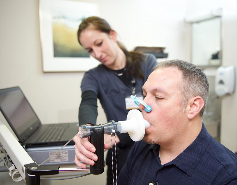 Technician conducting a breathing test.