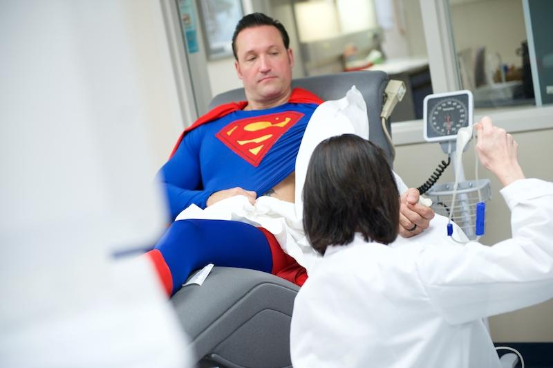 Superhero donating blood