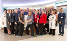 UI Health Care employees stand together for a group photo regarding the Beacon Award