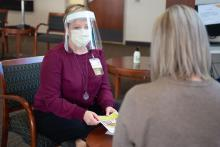 Social worker Cynthia West speaks with a patient