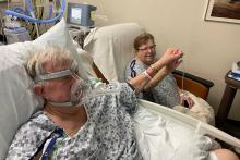 Joanne and Bill Bride hold hands at UI Hospitals & Clinics