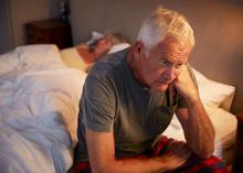 Man at side of bed