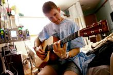 Noah Brown playing his guitar