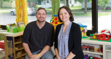 Darreld Peterson (left) with preschool teacher Nancy Bleuer (right)