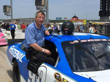 Keith Wilson sits in a race car