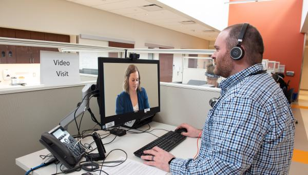 Photo of a patient and provider participating in a telemedicine appointment