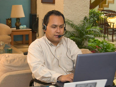 Man using a computer with a headset